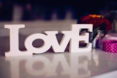 Composition de mot en bois d'amour Photographie stock