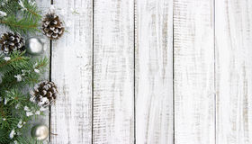 Composition with decorated Christmas tree on white rustic wooden. Background with copy space for text. Christmas mock-up or greeting card. Top view Royalty Free Stock Images
