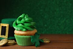 Composition with delicious decorated cupcake on table. St. Patrick`s Day celebration