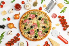 Composition with delicious pizza and ingredients. On white background stock photos