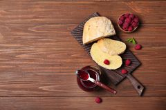 Composition with delicious raspberry jam on wooden table, top view. Beautiful composition with delicious raspberry jam on wooden table, top view Royalty Free Stock Photos