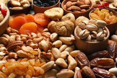 Composition of different dried fruits and nuts. Closeup royalty free stock photography