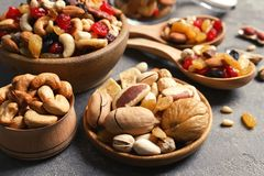 Composition of different dried fruits and nuts. On color background, closeup stock photos
