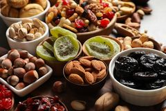 Composition of different dried fruits and nuts on table. Closeup stock photo