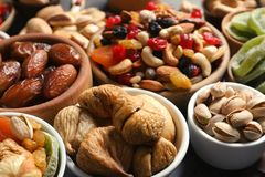 Composition of different dried fruits and nuts on table. Closeup royalty free stock photography