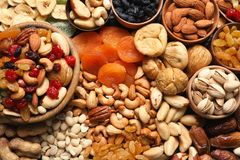 Composition of different dried fruits and nuts. Top view royalty free stock photography