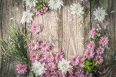Composition of different  flowers on the wooden background top view Royalty Free Stock Photo