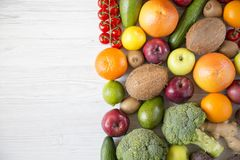 Composition with different fresh organic fruits and vegetables. royalty free stock photo