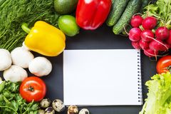 Composition with different fresh organic fruits and vegetables and notebook. stock photos