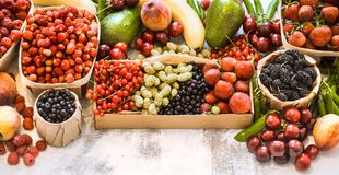 Composition of different fruits. In baskets on a light wooden background, concept of healthy nutrition and vitamins stock photo