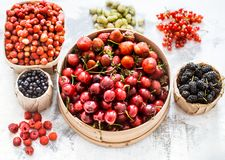 Composition of different fruits. In baskets on a light wooden background, concept of healthy nutrition and vitamins royalty free stock image