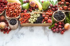 Composition of different fruits. In baskets on a light wooden background, concept of healthy nutrition and vitamins stock photos