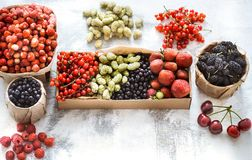 Composition of different fruits. In baskets on a light wooden background, concept of healthy nutrition and vitamins royalty free stock photo
