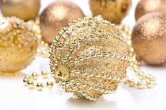 Composition with different golden Christmas balls Stock Photos