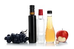 Composition with different kinds of vinegar. And ingredients on white background stock photos