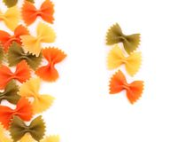 A composition of different pasta in three colors. Royalty Free Stock Image