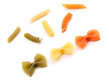 Composition of different pasta in three colors. Stock Image
