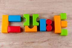 Composition of different plastic child`s blocks in the form of word Cube Royalty Free Stock Image