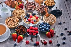 Different sorts of breakfast cereal products and fresh fruits. Composition with different sorts of breakfast cereal products and fresh fruits Royalty Free Stock Image
