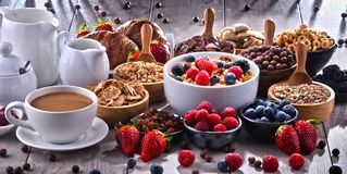 Different sorts of breakfast cereal products and fresh fruits. Composition with different sorts of breakfast cereal products and fresh fruits Stock Images