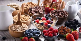 Different sorts of breakfast cereal products and fresh fruits. Composition with different sorts of breakfast cereal products and fresh fruits Royalty Free Stock Photo