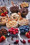 Different sorts of breakfast cereal products and fresh fruits. Composition with different sorts of breakfast cereal products and fresh fruits Stock Photography