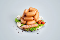 A composition of different sorts of sausages and meat on the woo Stock Photography