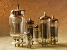Composition of different tipes electronic vacuum tubes in warm tones. Composition of different tipes electronic vacuum tubes in warm tones Stock Photography