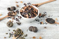 Composition with different types of dry tea on wooden background stock photography