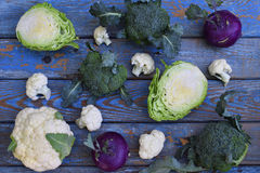 Composition from different varieties of cabbage on wooden background. Cauliflower, kohlrabi, broccoli, white head cabbage. Organic. Fresh vegetables Royalty Free Stock Image