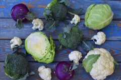 Composition from different varieties of cabbage on wooden background. Cauliflower, kohlrabi, broccoli, white head cabbage. Organic. Fresh vegetables Royalty Free Stock Photo