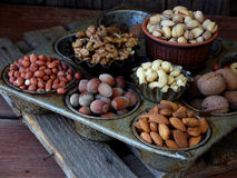 A composition from different varieties of nuts on a wooden background - almonds, cashews, peanuts, walnuts, hazelnuts, pistachios. A composition from different Royalty Free Stock Photo