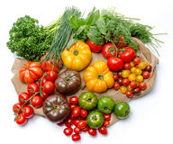 Composition of different varieties of tomatoes and herbs on a bu Stock Photography