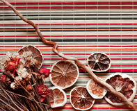 Composition of dried flowers and fruits. On bamboo background royalty free stock images