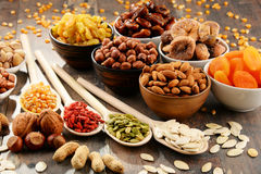 Composition with dried fruits and assorted nuts Stock Images
