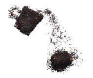 Composition of dry black tea on white background stock image