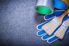 Composition of duct tape paint brushes safety. Gloves construction concept royalty free stock image