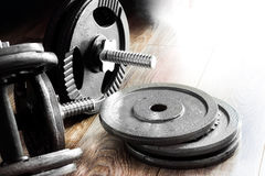 Composition of dumbbells and barbells. Stock Photos