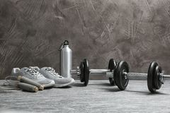 Composition with dumbbells and fitness accessories on floor. Space for text royalty free stock images