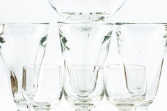 A composition of elegant transparent glasses for cocktails on a white background - close up Stock Image