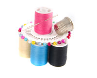 Composition of embroidery tool. Photo of a scissors ,thimble and spool with needle Stock Image