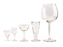 Composition of empty transparent glasses for cocktails and wine on a white background Stock Images