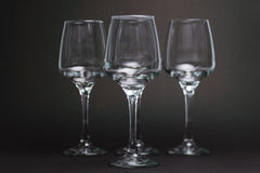 Composition with empty wine glasses on black background. Three empty wine glasses on black background Royalty Free Stock Photo