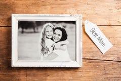 Composition en jour de mères Cadre de tableau Fond en bois Studi image stock