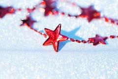 Composition en Noël avec les étoiles rouges Photographie stock