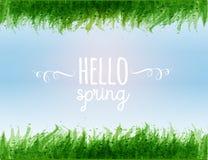Composition en typographie avec bonjour les mots de ressort, le ciel bleu et les feuilles vertes de l'herbe Image stock