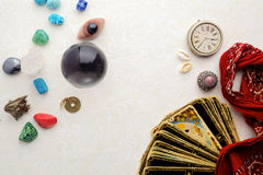 Composition of esoteric objects, used for healing and fortune-telling. On light background Royalty Free Stock Photography