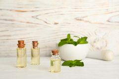 Composition with essential oil in glass bottles. On table stock photography