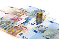 Composition of euro banknotes and coins Stock Images