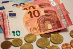 A composition of euro banknotes and coins Royalty Free Stock Photos